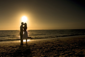 couple kissing at beach