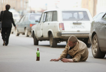alcoholic lies on the road