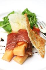 proscuitto ham rolled around fresh melon