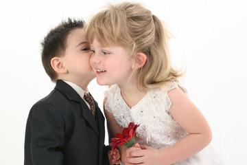 boy giving girl a kiss