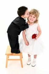 boy giving pretty girl a kiss