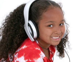 Wall Mural - adorable six year old girl wearing headphones
