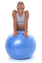 beautiful teen girl stretching on exercise ball