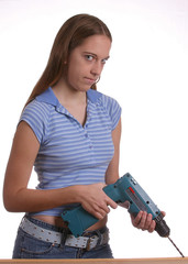 teen girl with cordless dril