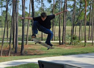 soaring teen skateboarder