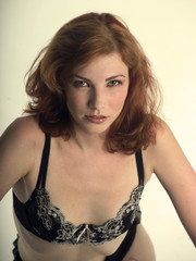 sexy red head in black lingerie