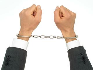 businessman's hands in handcuffs