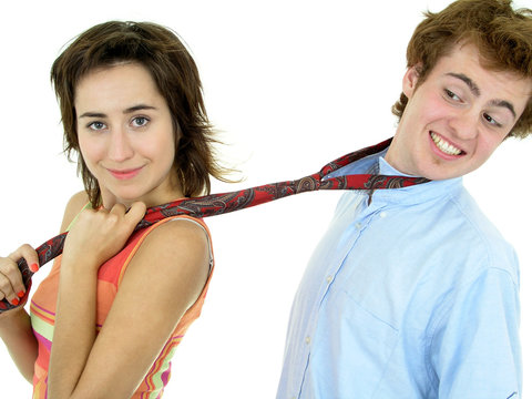 couple with woman pulling on man's tie