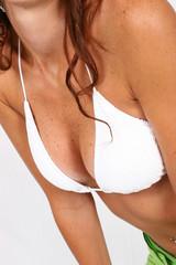 woman standing in bikini top