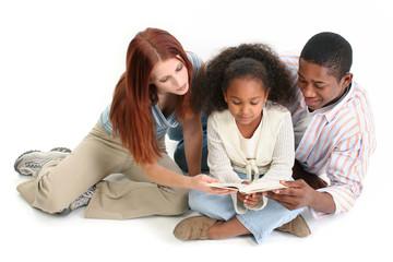 stock photography:  interracial family reading bib