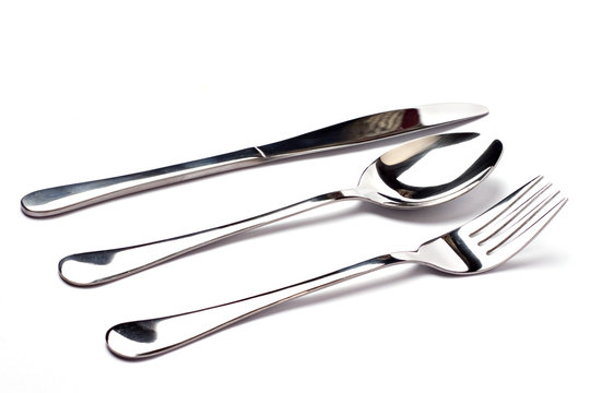knife, a spoon, and a fork on white background