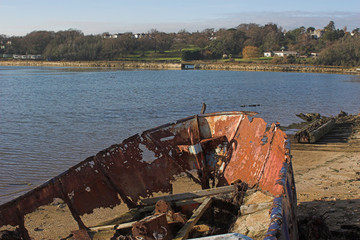 rusted wreck on shore