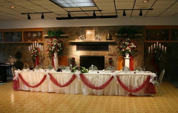 the head table at the reception of a wedding.