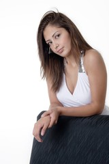 pretty young woman relaxing leaning on back of cha