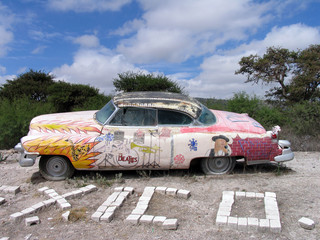 old colorful car in desert