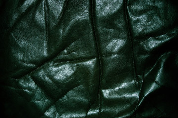wrinkled old black leather