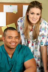 doctor and nurse smiling