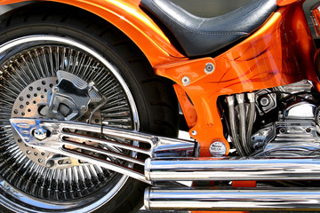 low seat, fat tyres, orange paintwork and tons of chrome on a ch