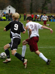 players battling for ball