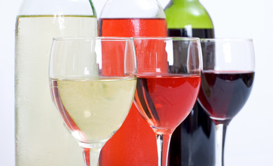 3 wine bottles and glasses