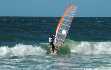 windsurfer taking on the wave