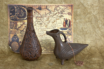still life with two jugs and ancient map