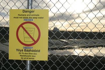 danger warning sign in english and navajo