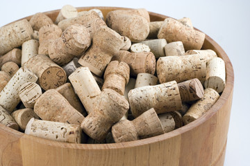 wooden bowl full of wine & champagne corks.
