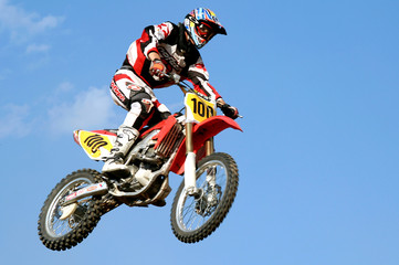 Poster Motorise red motocross in the sky