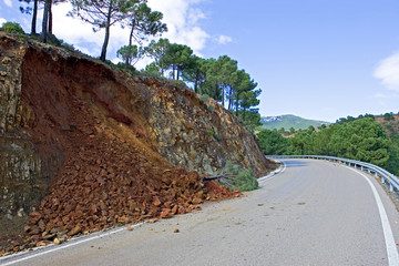 land or mudslide on mountain road after storm