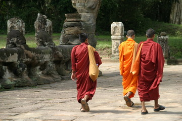 a group of monks leave one of the angkor temples