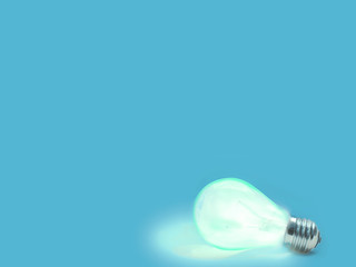 blue  background with lit lightbulb