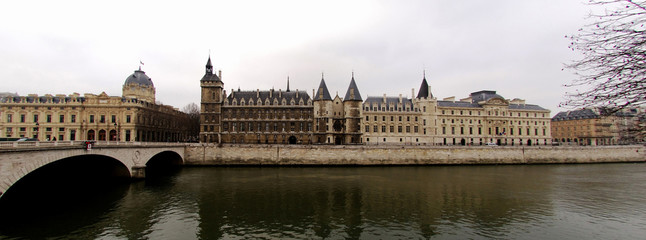 france, paris: seine river, la conciergerie in winter