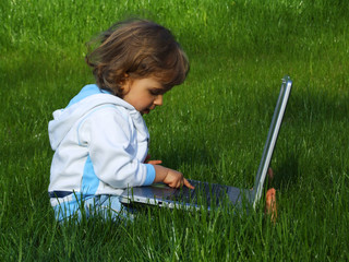 girl with laptop on grass