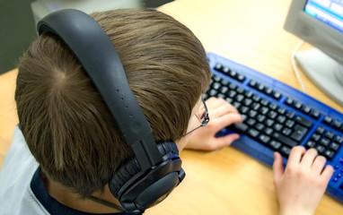 computer kid w/ headphones