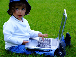 girl with laptop on the grass