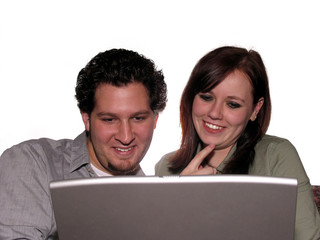 couple with laptop on white