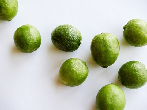 green key limes on white background