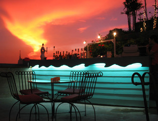 dramatic rooftop bar at sunset