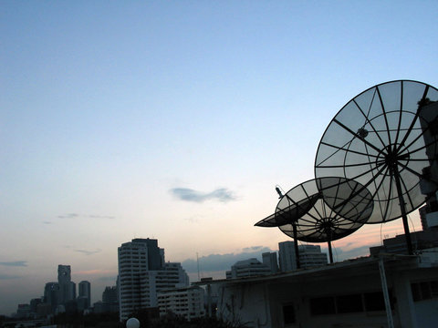satellite dishes at sunset