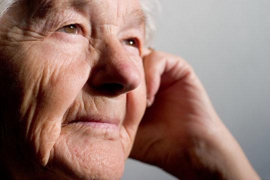 elderly woman contemplating