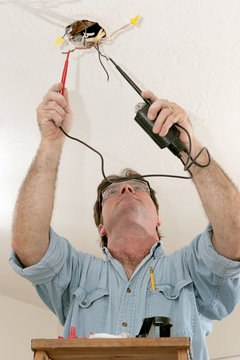 electrician testing voltage
