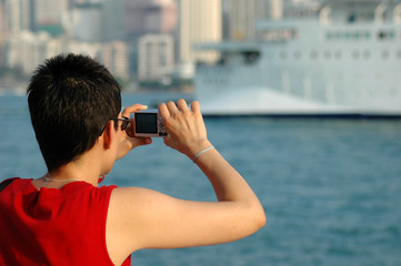 lady taking picture with a digital camera