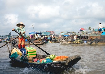 woman on the floating market, mekong delta