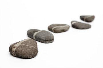 Row of stepping stones on white background