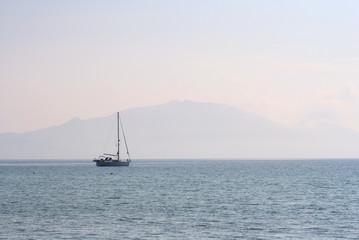 yacht & misty mountain at dusk