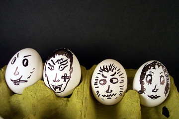 face drawing on four eggs