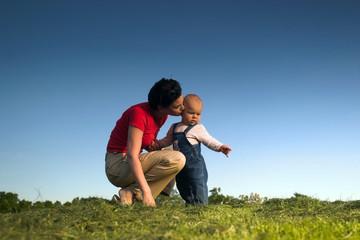 baby, mother, grass and sky