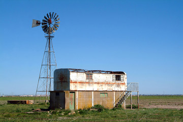 old farm and windmill