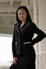asian business woman with hand on hip